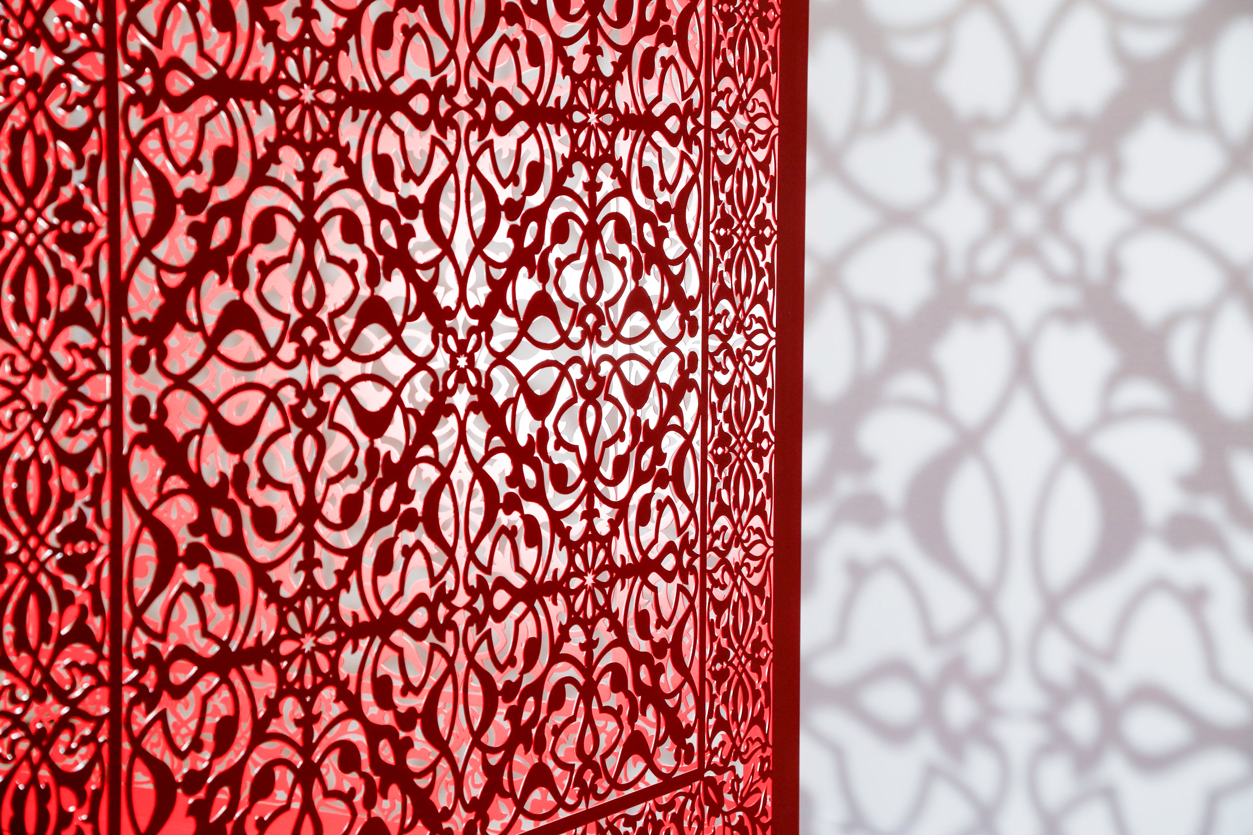 "Shimmering Mirage - Red (Detail)   Lacquered steel and halogen bulb  48"" x 48"" x 48"" 2019"