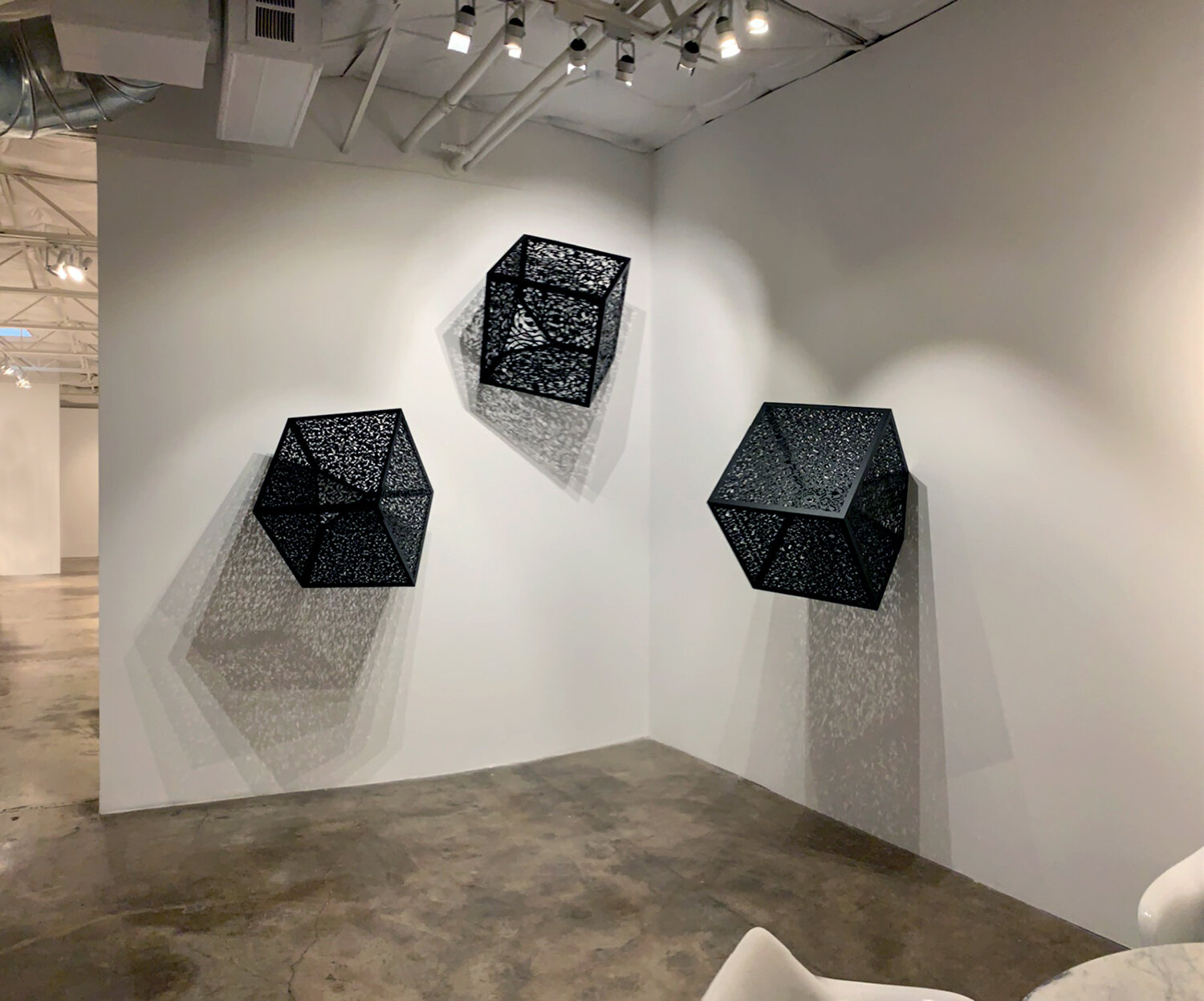 Itinerant Shadows  Installation at Talley Dunn Gallery, Dallas, TX, 2019    Laser-cut Black Lacquered Steel  2' for each cube