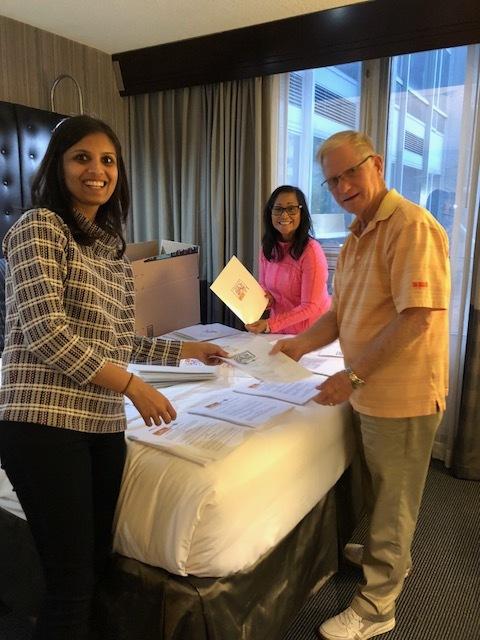 2020 Mom team stuffing registration folders. (Vrinda Devani, MD, board member; Millie Pagett, RN volunteer; Ed Pagett, volunteer and advocacy team member)