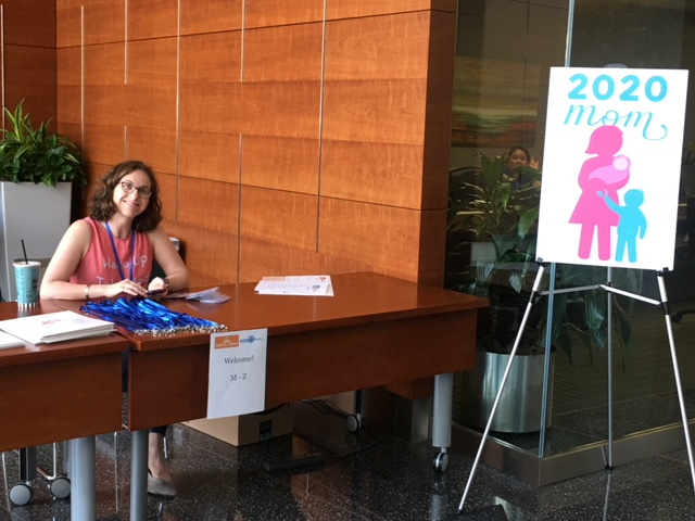 2020 Mom's beloved advocacy intern, Sarah Kotranza, at the registration table.