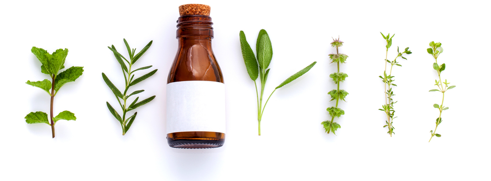 Homeopathic medicine bottle and natural herbs