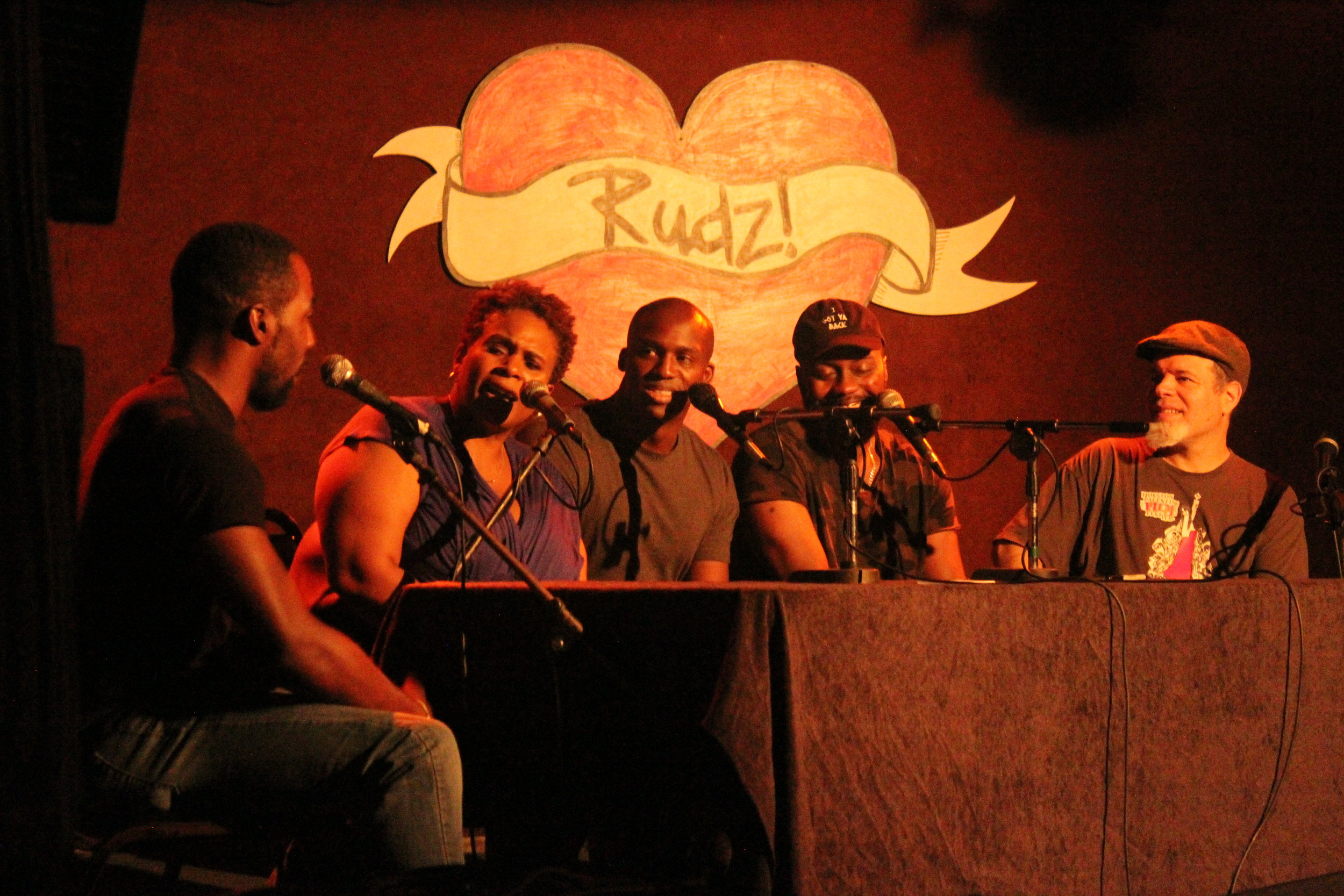 Award-winning & nationally touring opening improv comedy act   Can't Tell Us Nothing   troupe members Antoine, Tandi, Amechi, and Jon interview their guest  Nick Cooper  (  Free Radicals  ,   Houston DSA  ). The comedians jump back and forth between scenes & characters made up on-the-spot, and the guest interview whose answers inspire the next comedic scene.