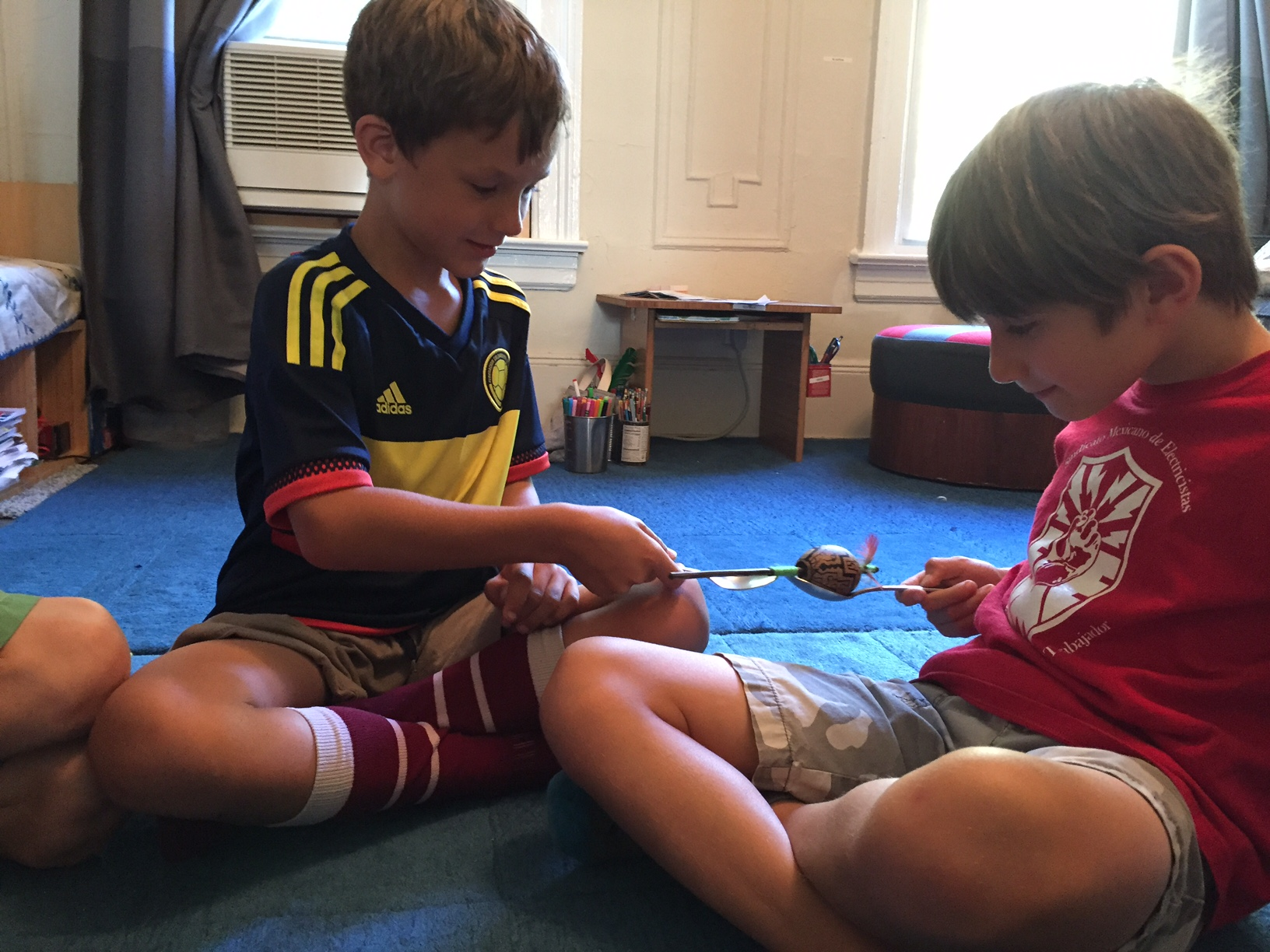 Group games build fine motor skills, focus, self-control and self/other awareness