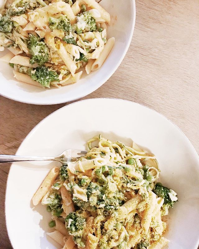 Sharing the YUMMIEST creamy tahini pasta recipe with you all tonight! So simple, so delicious and so creamy. All from plants! Feel free to get creative! Take out or add any veggies you like! This usually feeds us with a little leftover! x Ingredients: 3 zucchinis - spiralized 1/2 sweet onion 1 head broccoli 1 cup peas 1 bunch of asparagus 1 clove minced garlic 1 handful spinach 8oz pasta (we use brown rice or banza pasta) Sauce: 1/3 cup tahini 2/3 cup plant milk 2 tbsp nutritional yeast 1 tsp paprika 1 tsp red pepper flakes 1/2 lemon juiced Salt and pepper to taste Blend or stir together all sauce ingredients x STEP 1: BEGIN BY SPIRALIZING YOUR ZUCCHINI AND CHOPPING YOUR ONION, BROCCOLI, AND ASPARAGUS. ONCE ALL VEGGIES ARE CHOPPED ADD ONIONS TO A SAUTE PAN WITH A DRIZZLE OF OLIVE OIL AND COOK UNTIL TRANSLUCENT. ADD BROCCOLI, PEAS AND ASPARAGUS TO THE PAN WITH A SPLASH OF WATER AND COVER WITH LID UNTIL SOFTENED AND STEAMED, STIRRING AND ADDING WATER AS NEEDED. x STEP 2: WHILE VEGGIES ARE COOKING START TO BRING WATER TO A BOIL FOR YOUR PASTA AND COOK ACCORDING TO PACKAGE, DO NOT OVERCOOK. ONCE PASTA IS DONE COOKING DRAIN AND ADD TO SAUTÉED VEGGIES ALONG WITH GARLIC AND HANDFUL OF GREENS.  x STEP 3: ADD IN ALL SAUCE INGREDIENTS AND STIR TO COMBINE. x SERVE WITH EXTRA NUTRITIONAL YEAST AND S&P!