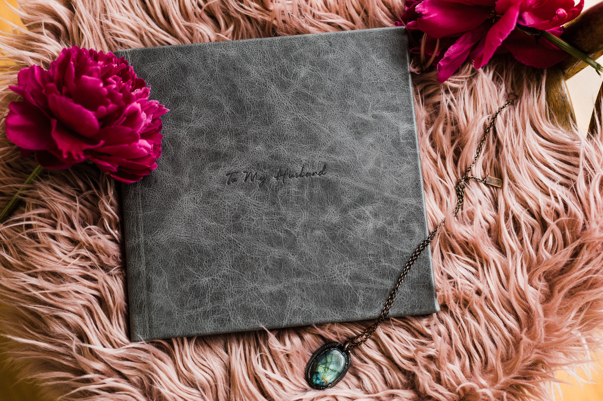 """- Albums consists of a gorgeous, 20 page lay-flat album in a size of your choosing and come with a complimentary charcoal box for storing. Covers are limited to material only- Leather, Linen or Velvet.Available in sizes: 8x8"""", 10x10"""" and 12x12""""Prices start at 1200"""