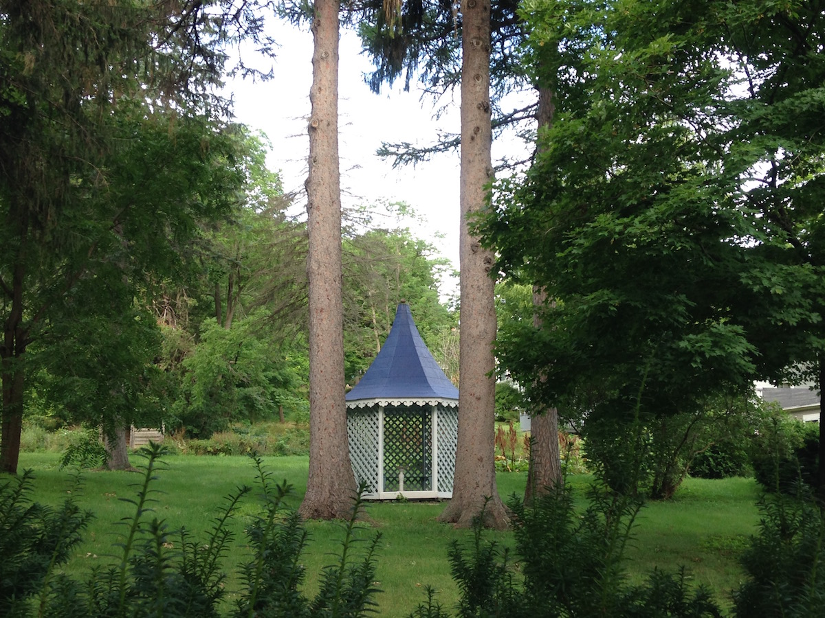 A blue-roofed summerhouse pops in the pine grove is sits in on Main Street
