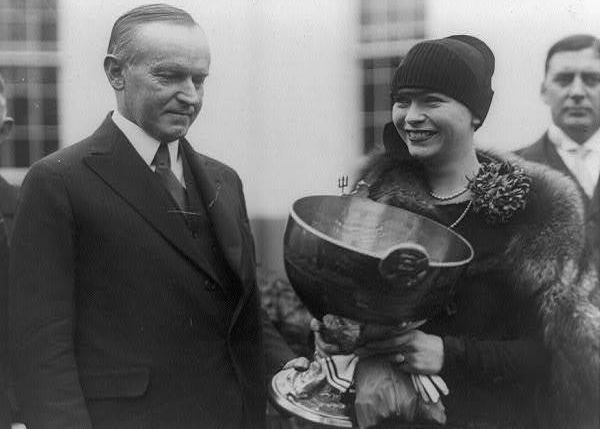 Delphine being presented her trophy by President Calvin Coolidge