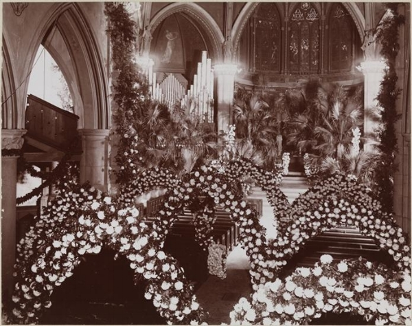 Floral arches and a bank of Palm trees at St Thomas Church