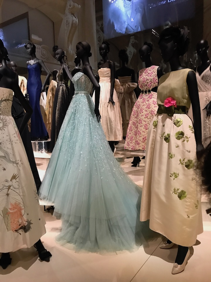 In this tableau, one can see dresses worn by Liz Taylor (front right) and Princess Diana (upper left)