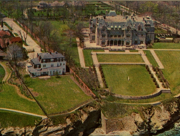 Ochre Court (right) dwarfs its neighboring cottage from an earlier era