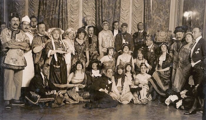 Amy (seated center with star in her hair) and some guests at one of her costume parties