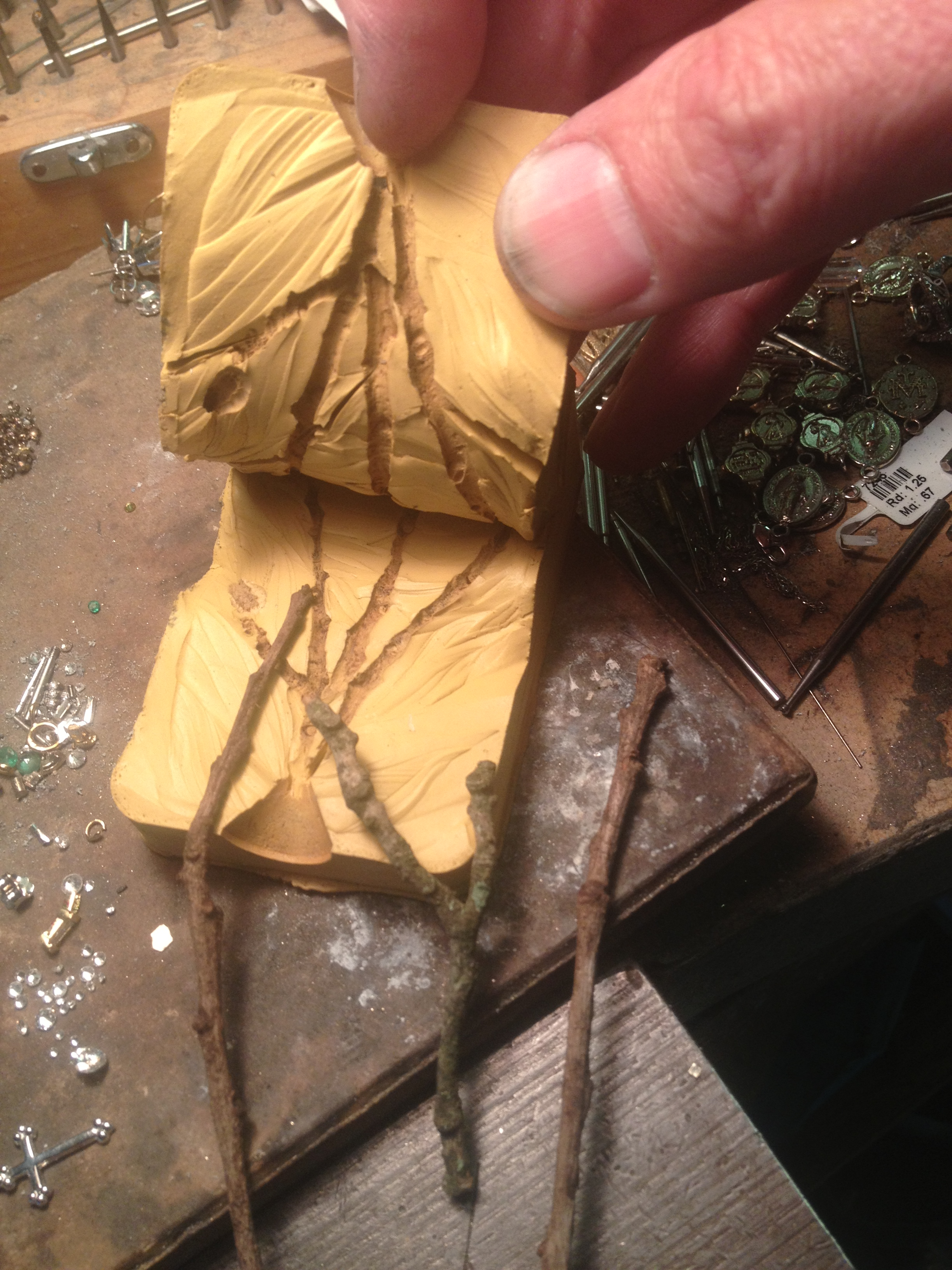 Using the collected twigs, we make a rubber mold of each elament of the necklace