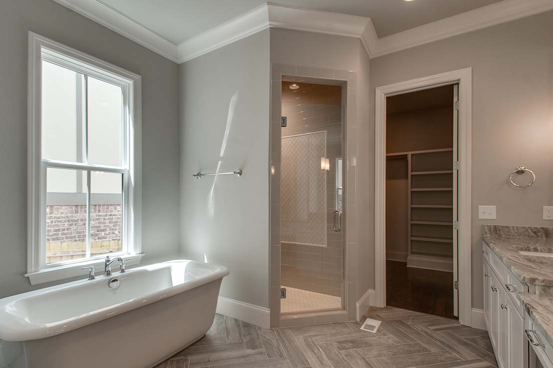 House-Plans-Online-Selections-Nashville-Peggy-Newman-Finishes-Master-Bath-Tub-Large Shower-Storage.jpg