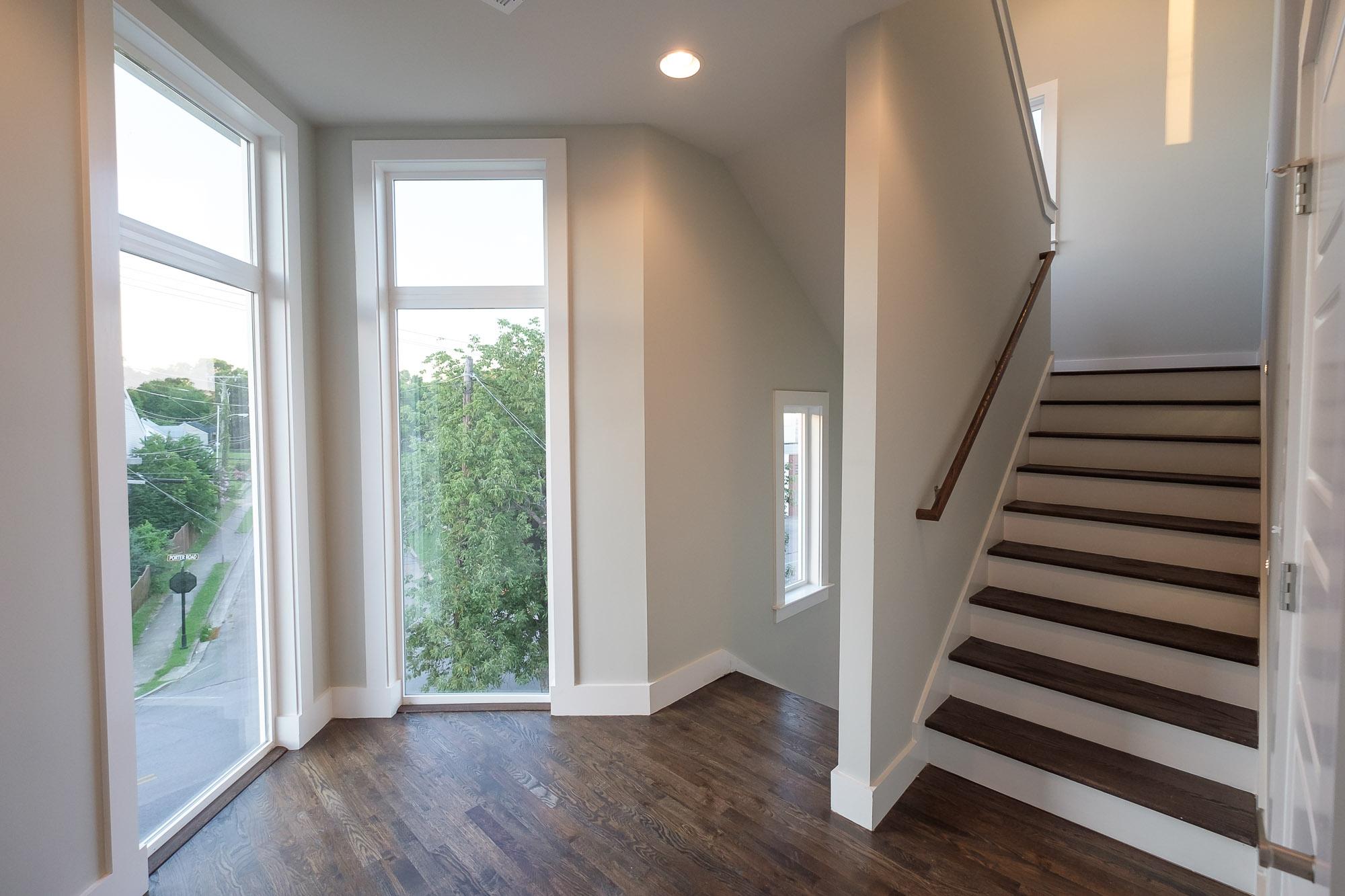 House-Plans-Online-Duplex-Nashville-Peggy-Newman-Stairs-Ceiling to Floor-Windows-Porter.jpg