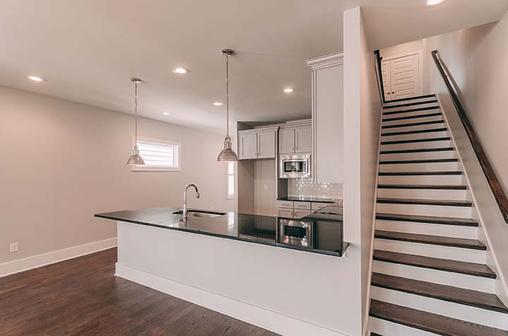 House-Plans-Online-Four Square-Nashville-Peggy-Newman-Family-Stairs-Kitchen-Spain.jpg