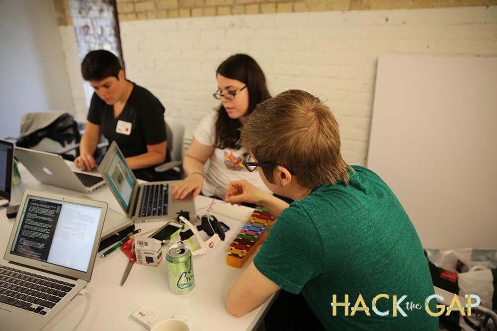 Team Neuro Visionaries hacking on their brainwave bio feedback project.