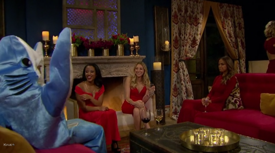 Would you rather show up to this party in red, or in a shark suit while claiming you're a dolphin? Alexis chose the latter.