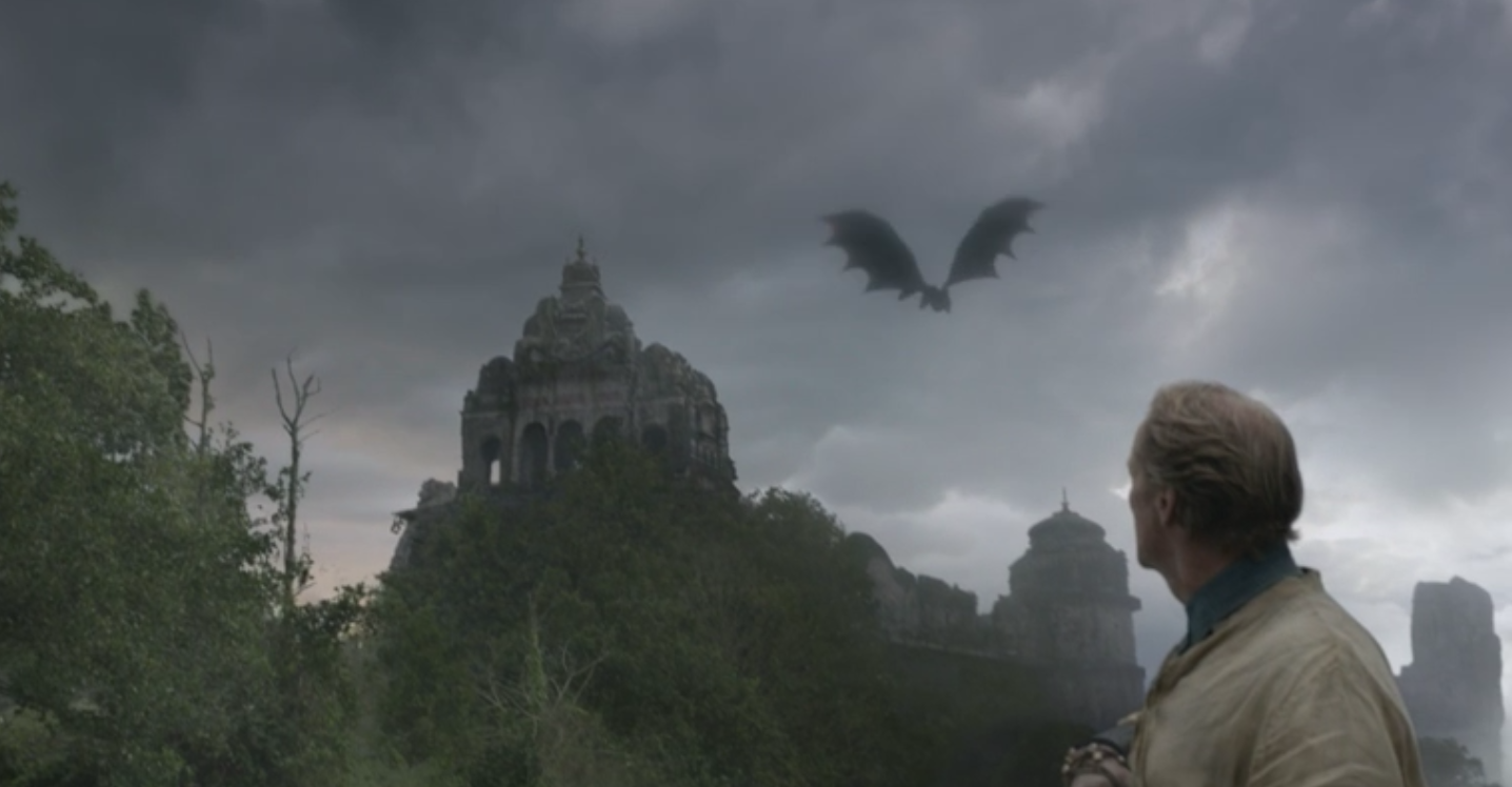 Drogon flying above Jorah and Tyrion near the ruins of Old Valyria in   Kill the Boy  (S5E5)