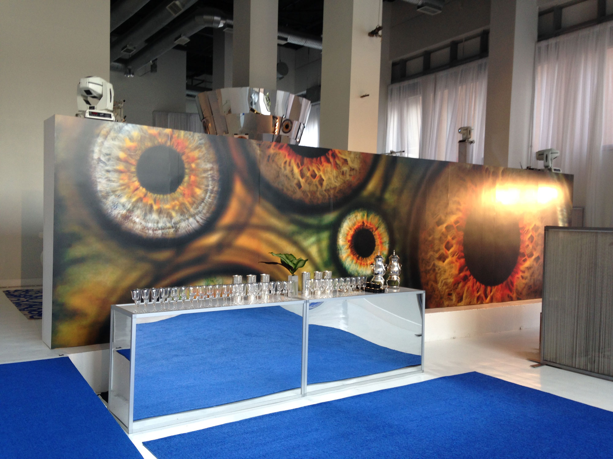 8'Tall x 32'Wide custom constructed wall to divide venue space with vinyl adhesive digital print of custom graphic.