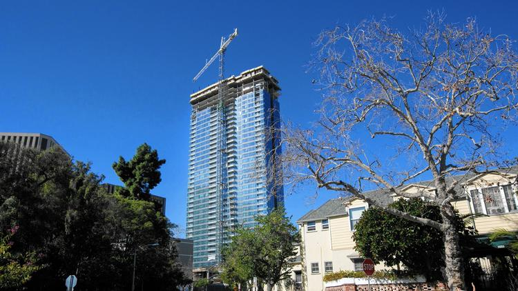 Miami developer Crescent Heights plans to open a 40-story luxury apartment tower this summer in Century City. It will have a private theater, on-call luxury cars with drivers and personal trainers. (Marcus Yam / Los Angeles Times)