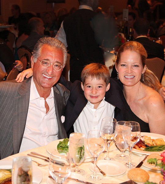 Del Bryant, son Thaddeus and wife Carolyn enjoy the Michael Bolton Charities and Dave Mason Benefit Concert and Celebrity Golf Classic.  (Photo by Stuart Walls )