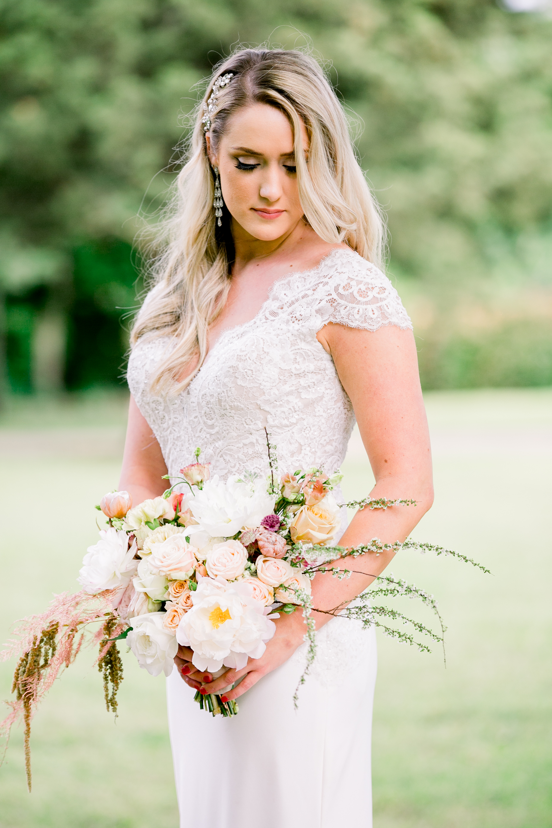 My jaw literally DROPPED when I saw the dress, flowers and stunning model all together! We were seriously blessed to work with so many talented Oklahoma artists!
