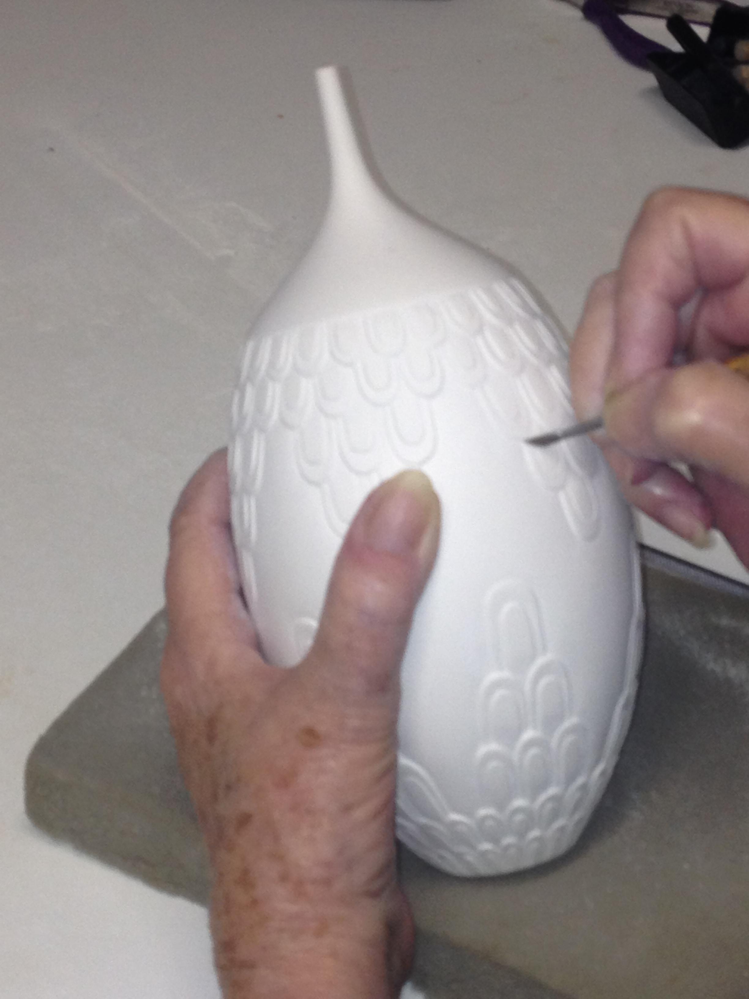 Carving on unfired, bone-dry porcelain.