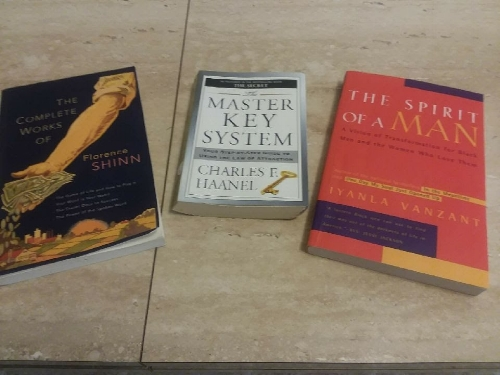 """Good reads recommended by Tojo L to R: """"The Complete Works of Florence Shinn"""", """"The Master Key System by Charles E. Haanel, """"The Spirit of A Man"""" by Iyanla Vanzant"""