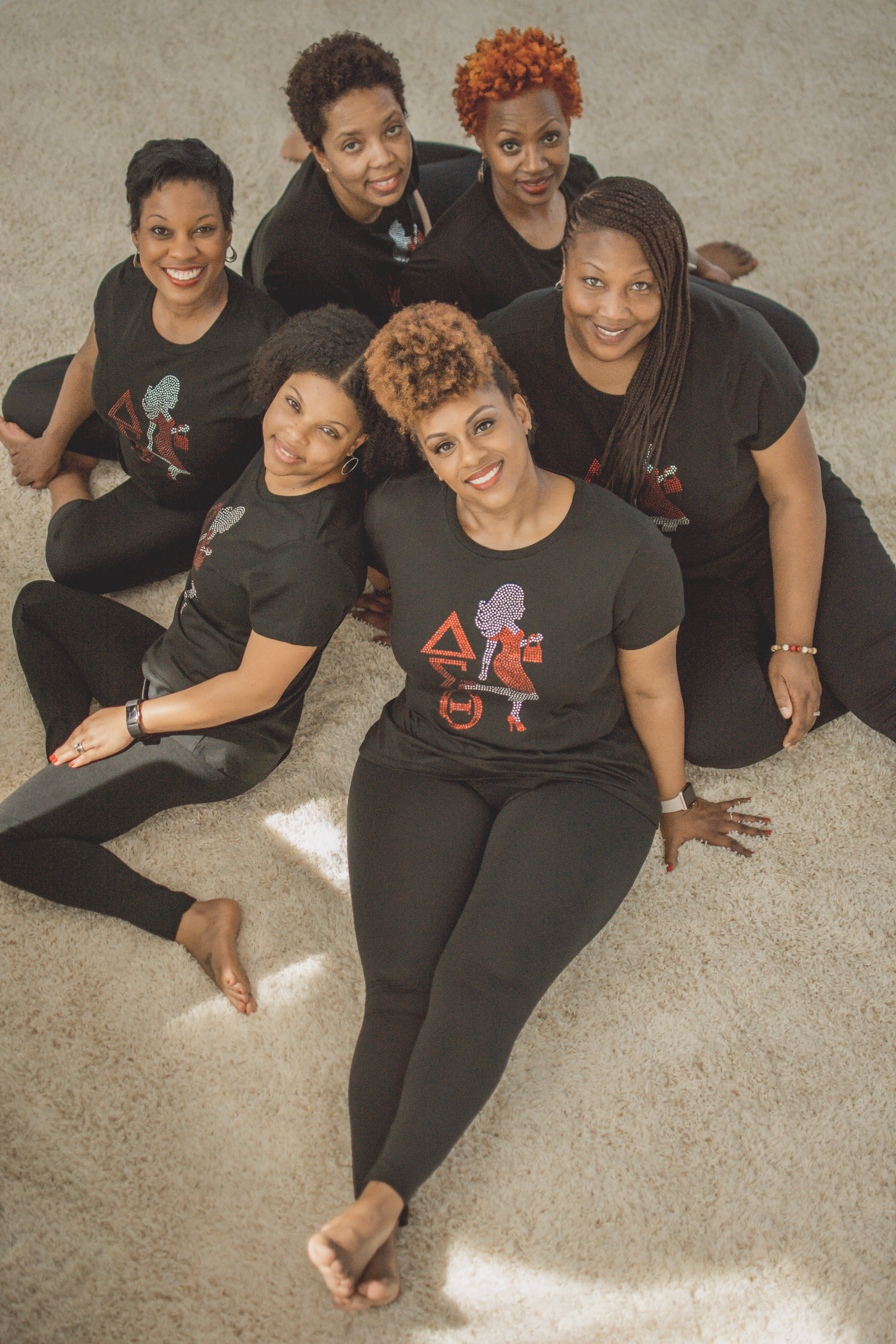 Rona Dana (center) and her line sisters, the ladies of Delta Sigma Theta Sorority, Inc.