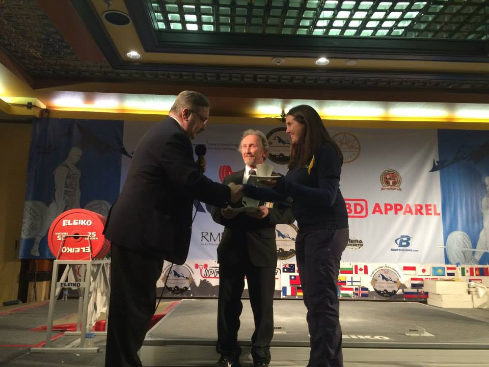 receiving an award for contribution to the sport