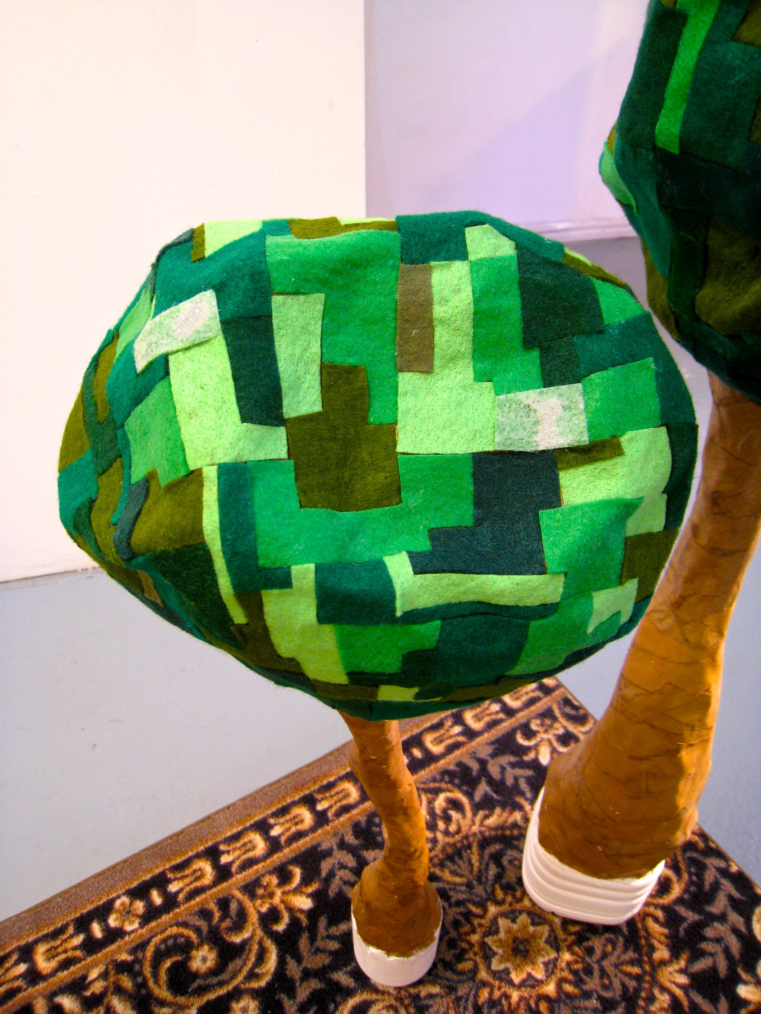 Subliminal Rapture Rug, 2010 detail: felt 'farmland patchwork' trees, paper mache, plaster base