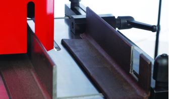 Notching  This station comes standard with rectangular notching blades which allow side notching, therefore allowing notching of unlimited widths. Vee notching blades can easily be installed, and are available as an option.