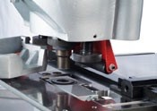 Quick Change Punch Tool Equipment   The punch station is designed with versatility in mind. The machine is equipped for punching of flat bar, angle iron, and channel. The station comes standard with quick change punch & die holders, as well as a swing away stripper. Optional tools for the punch station are: pipe notching tool, and press brake attachment. Quick change punch equipment to 40mm