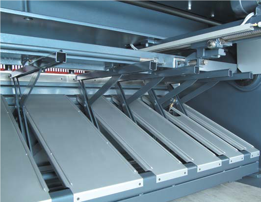 "Rear Sheet Support Systems  For the cutting of thin or delicate material consider a rear sheet support system.  These systems support the sheet to prevent it stooping down and passing under the back gauge.     - Pneumatic thin sheet support device - Durma I  - Pneumatic thin sheet support device ""two steps"" - Durma II This option is more advanced by not only supporting the sheet but gently lowers the off-cut to the ground to prevent damage to delicate materials.  - Pneumatic thin sheet support device ""Return to sender"" - Durma III After the cut process the off-cut is returned out the front side of the machine.  Therefore the operator does not have to go around the back to collect."