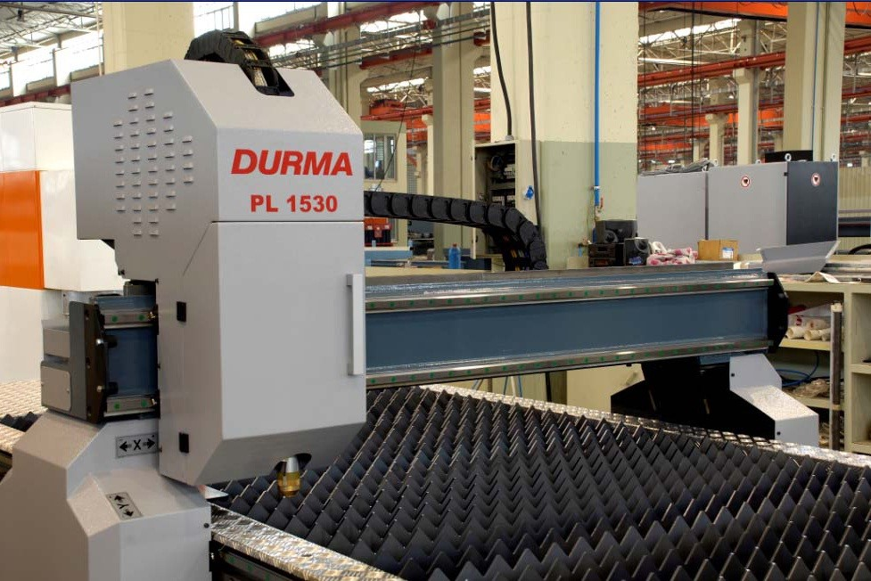 DURMA Rigid Construction  The DURMA model PL 1530 plasma cutting machine is a 2D system.  It features rigid bridge type construction with bearing linear guideways.  The precision rack and pinion system moves the bridge on the Y1 – Y2 axis and torch carrier on the X axis.  The CNC controller synchronises the Y1 – Y2 movement.  The double side drive system allows backlash free, high cutting quality.