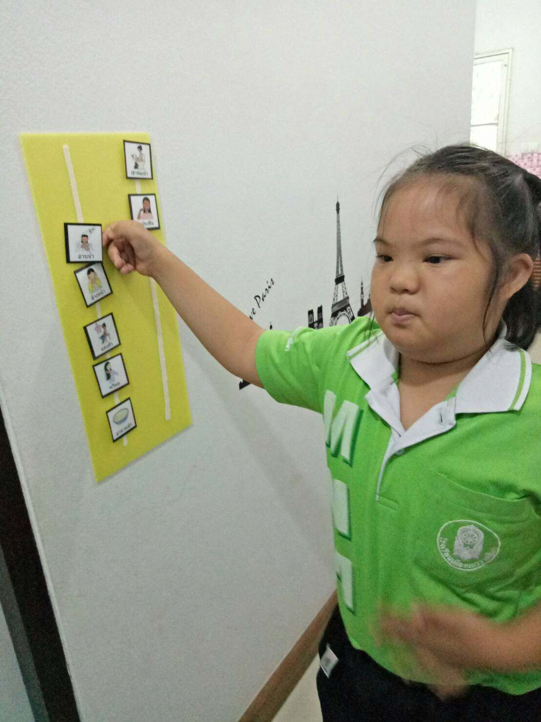 Using the picture schedule to complete daily living skills independently.