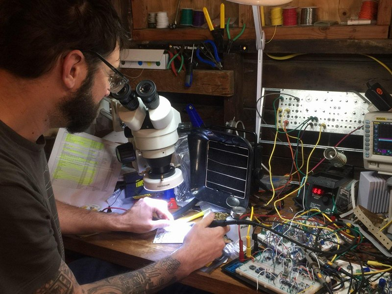 Here's a shot of Eric Schlappin' some 0603's onto a PCB