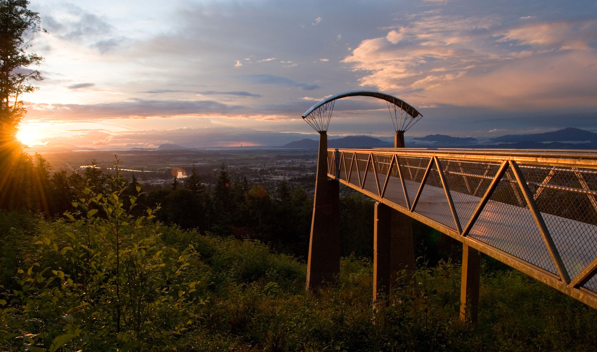 The North Viewpoint's stylish design let's you imagine yourself as paraglider looking down on the city of Mount Vernon and the lower Skagit Valley. Across the horizon from west to east are Padilla Bay, North Puget Sound, the San Juan Islands, Blanchard Mountain, the Chuckanut Range, and finally Mt. Baker.  Photo © Rob Barker