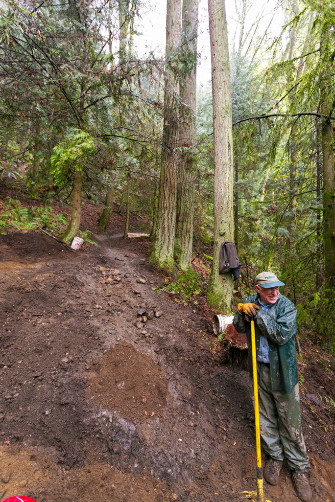 Trail Builder Extraordinaire, Jerry Granahan, reshaping the new, mountain bike flow trail.
