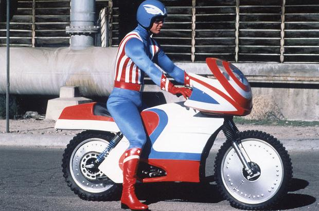 Captain America riding his vintage motorcycle.
