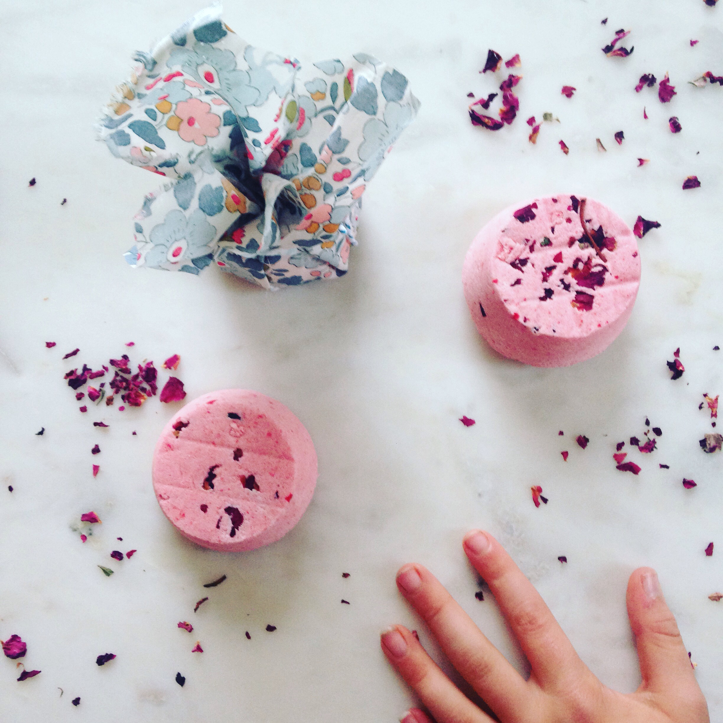 Recipe for Winter Love Bombs.  INGREDIENTS.  300g Bicarbonate of Soda,  100g Citric Acid  10ml Fragrance or Essential Oil of your choice (for sensitive babes use half)  Colour - most food colours are fine.   Razzamatazz- glitter, rose petals, confetti, go wild.  METHOD...  1. Brush a little olive/almond oil inside your mould (silicone ice cube trays or cup cake moulds work a treat)  2. Combine the bicarb, citric acid with food colouring and mix together with your hands.  3. Add your essential oils and mix to combine.  4. Spray a little water into the mixture, just enough so that it holds together when you squish it in the palm of your hand.  5. Add your razzamatazz (glitter, rose petals etc).  6. Push into your moulds and leave to dry out for 2-3 days.