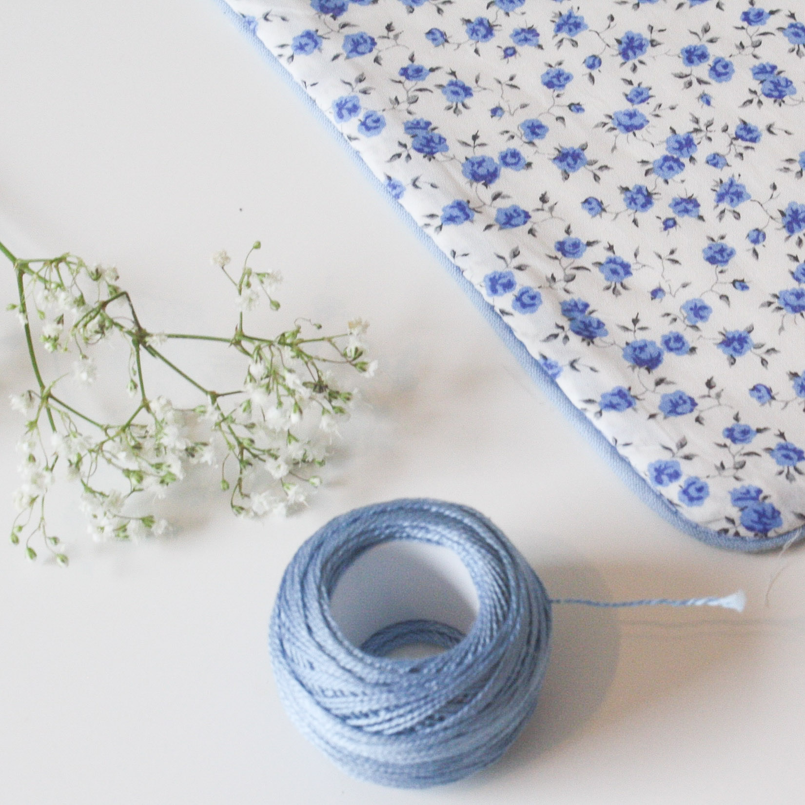 The quality and detail of my quilt and covers are next to none. They'll be treasured for years. Beautifully packaged - I am thrilled! Rae March 2017  Hand stitched Quilt in Liberty Print 'Nina'. Piped in blue cotton with pure white linen on the reverse.