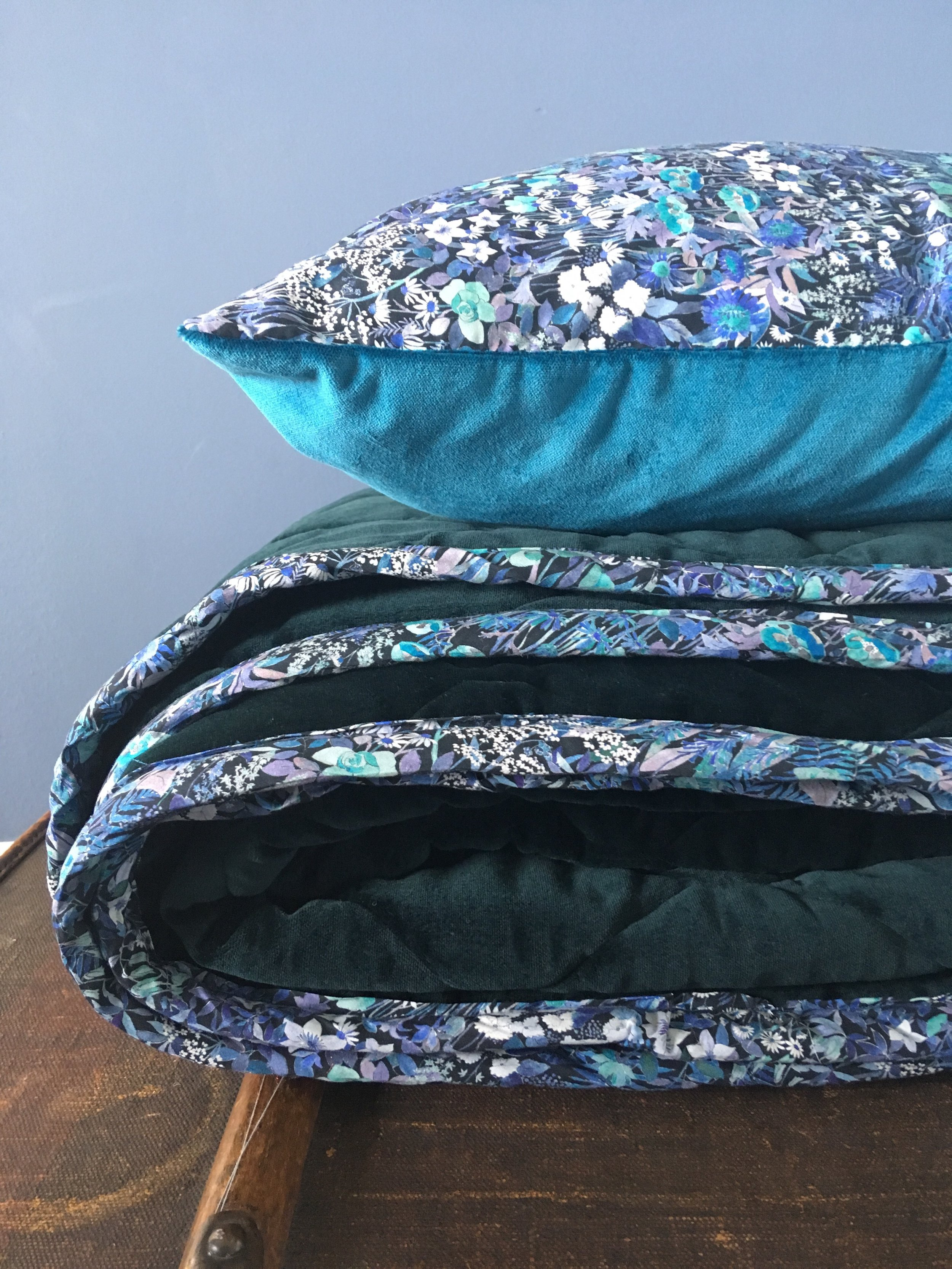 Cushion in Liberty of London 'Faria Flowers' with Athenian Blue Velvet.  Quilt in ocean green velvet with trim in Liberty of London 'Faria's Flowers. Available in Double and King Size or by custom order.