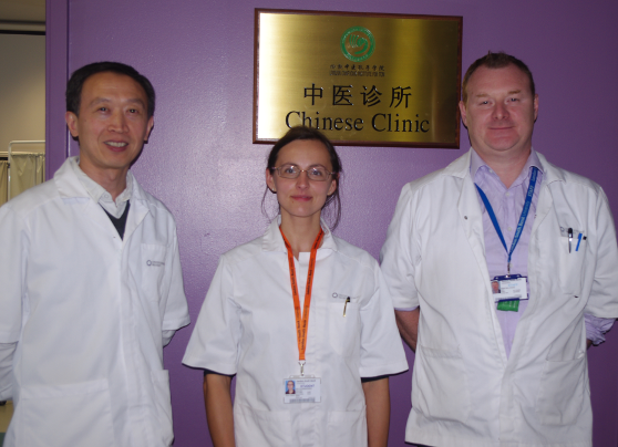 Iga in Confucius Institute's clinic with Huang Weidong and Martin Logue
