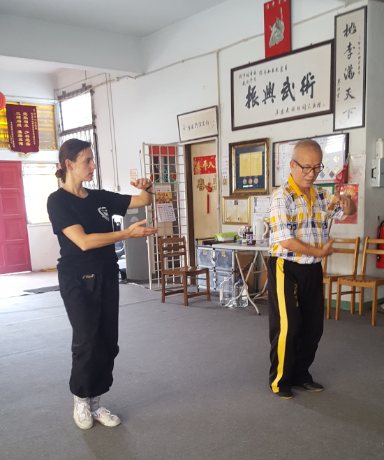 Master Teng teaching me. You can see how much more tension there is in my arms and whole body as compared to his!