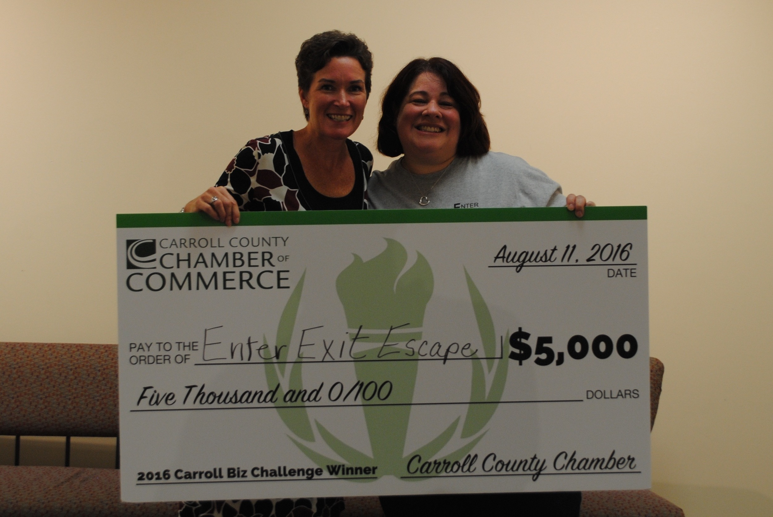 Business partners, Kristen and Lisa, with the big check! :)