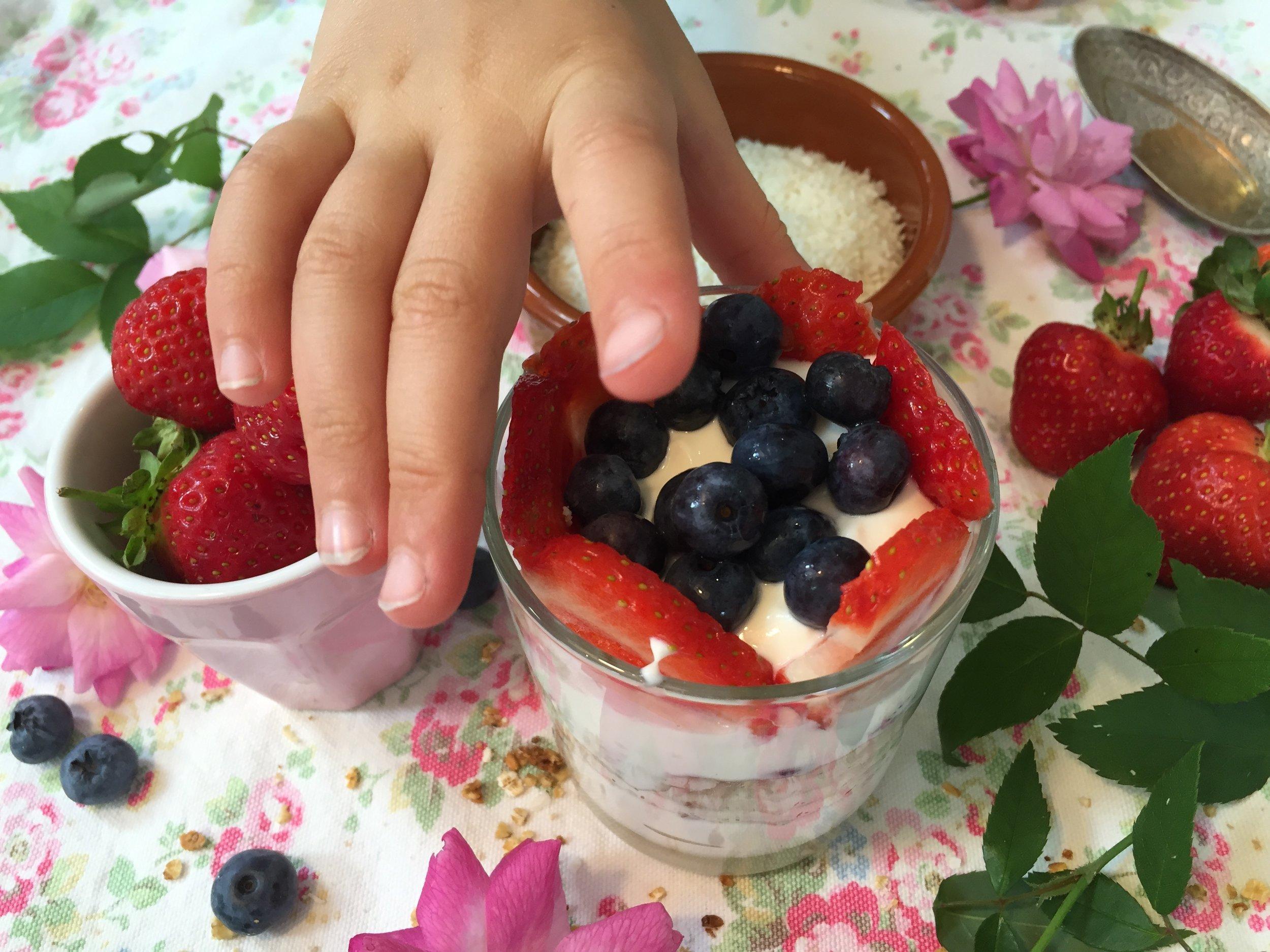 Fruit, yoghurt, granola hand.jpg