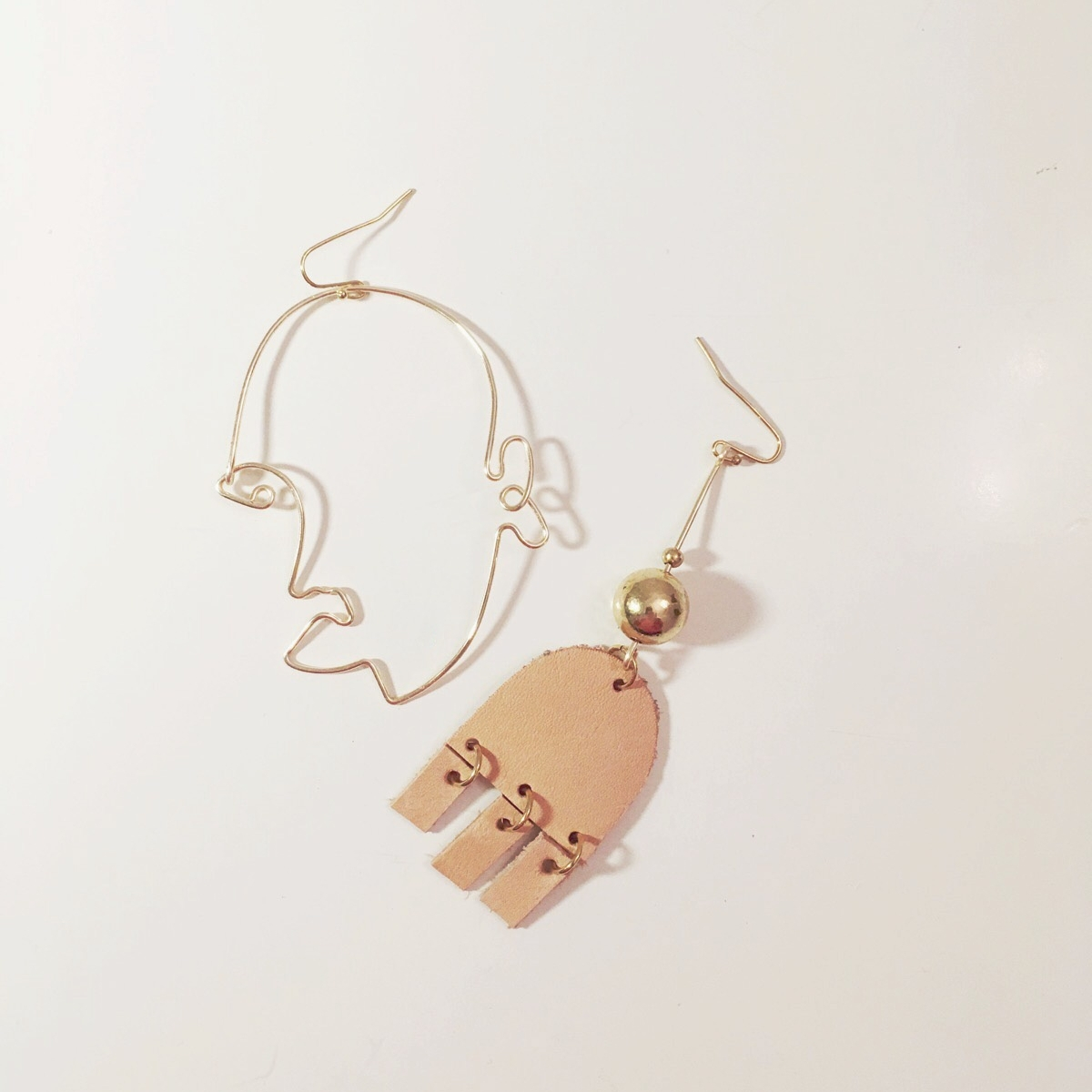 LEATHER SILHOUETTE EARRING SET  WHOLESALE $65  SRP $120