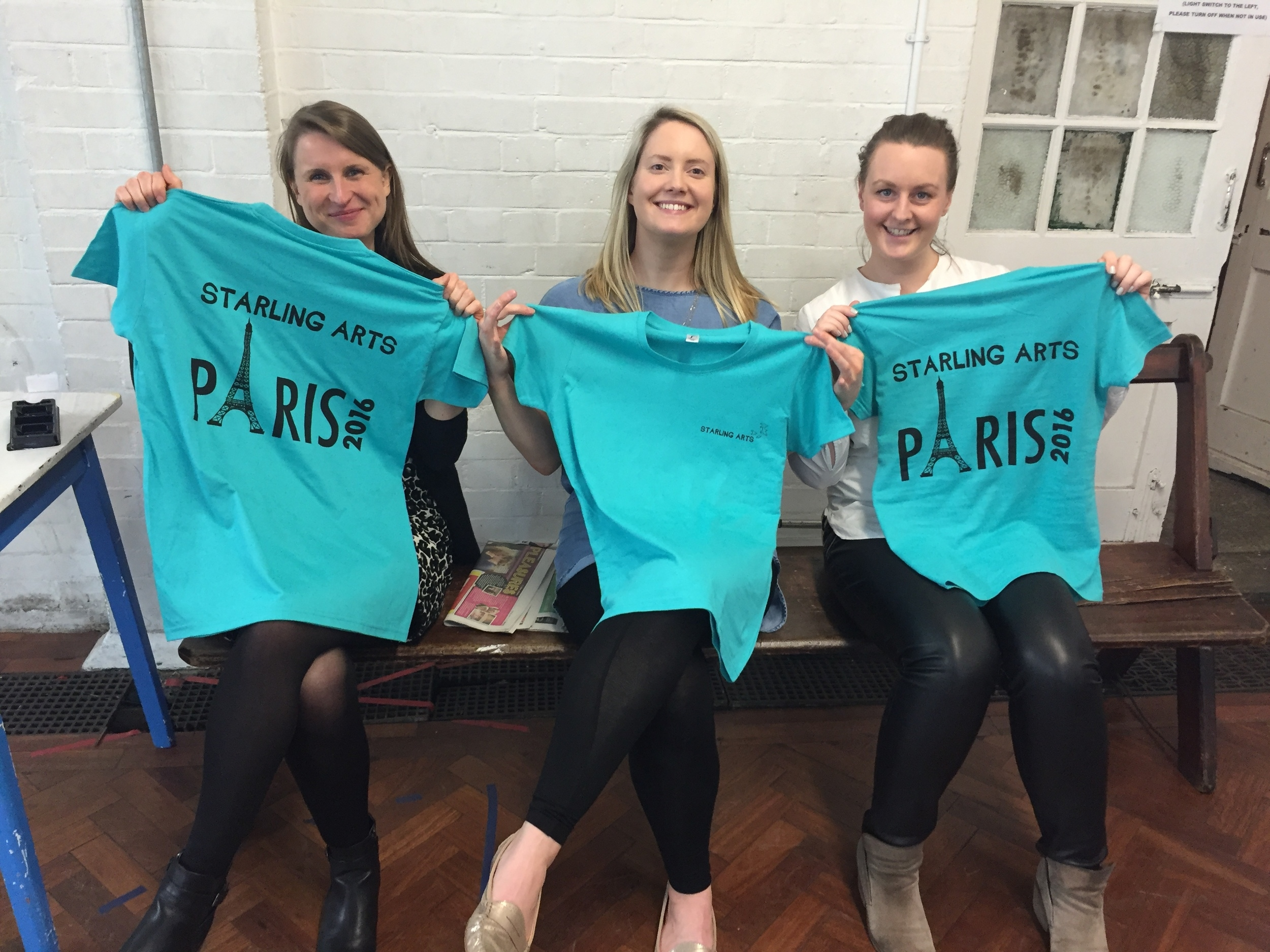 Some of our members show off their special tour t-shirts at rehearsal