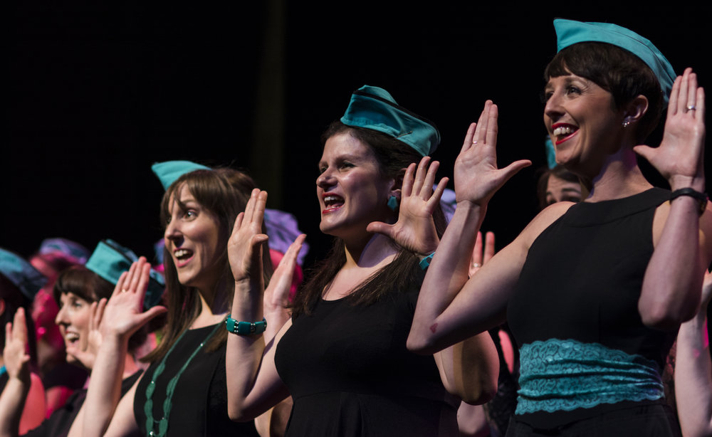 Our choir Corvida performing a close harmony number, with accompanying movements! Photo by Rebecca Pitt